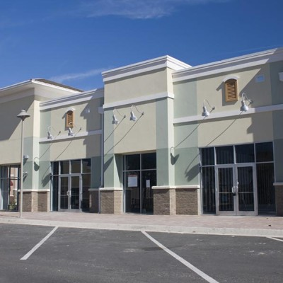 newly constructed commercial mall with brick accents